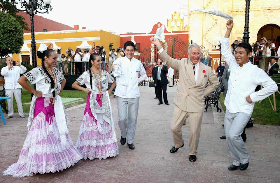 <p>During a trip to Campeche in Mexico back in November 2014, Prince Charles had a go at traditional Mexican clog dancing in Zocalo Square. <em>[Photo: Getty]</em> </p>