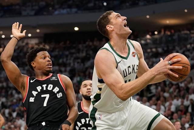 The Bucks' Brook Lopez shoots past the Raptors' Kyle Lowry during the first half of Game 1 Wednesday night. (AP Photo/Morry Gash)