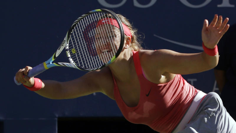 Victoria Azarenka, of Belarus, returns a shot against Flavia Pennetta, of Italy, during the semifinals of the 2013 U.S. Open tennis tournament, Friday, Sept. 6, 2013, in New York. (AP Photo/David Goldman)