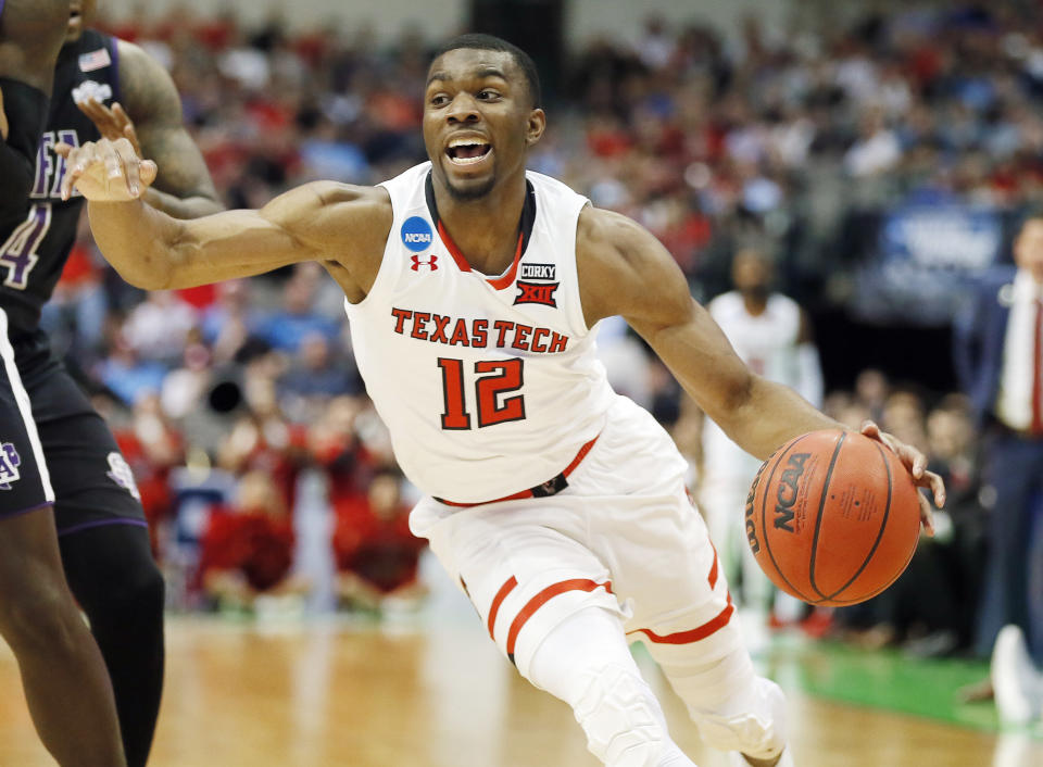 FILE - In this Thursday, March 15, 2018, file photo, Texas Tech guard Keenan Evans (12) looks for room against the Stephen F. Austin defense during the first half of a first-round game at the NCAA college basketball tournament in Dallas. The All-Big 12 guard now has a postseason win, and he seems to have shaken off a troublesome foot injury that affected him for several games. (AP Photo/Brandon Wade, File