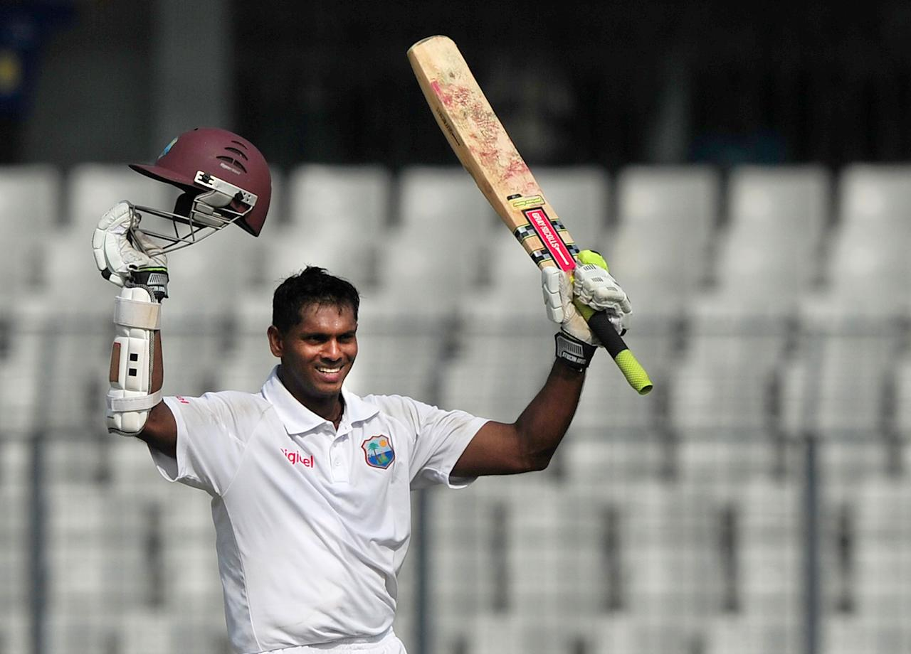 West Indies cricketer Shivnarine Chanderpaul acknowledge the crowd after scoring a double century during the second day of the first Test match between Bangladesh and West Indies at the Sher-e-Bangla National Cricket Stadium in Dhaka on November 14, 2012.   AFP PHOTO/ Munir uz ZAMAN
