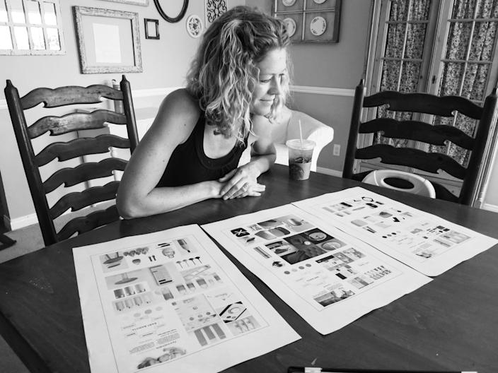 A potential Baby Barista customer looks at designs and plans for the machine, which instantly produces formula for waiting babies.