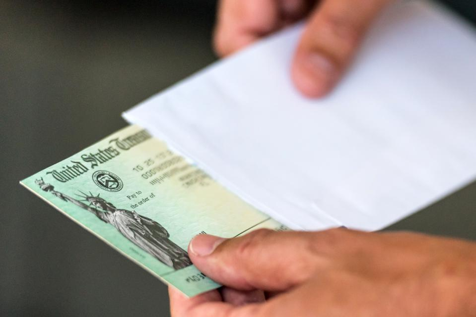 If the IRS doesn't have direct deposit information on file, checks will be mailed, which could take longer to get to Americans. (Photo: Getty Creative)