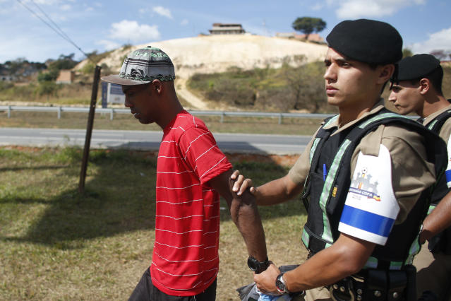 Police arrest Brazilian Denis Andre Oliveira, 33, for entering the Cidade do Galo sports complex where the Argentine soccer team trains in Vespasiano, near Belo Horizonte, Brazil, Wednesday, June 18, 2014. Oliveira said he wanted to get an autograph of Argentina's Lionel Messi. On June 11, Oliveira shone Messi's cleats after invading the training of Argentina at Independencia Stadium. (AP Photo/Victor R. Caivano)
