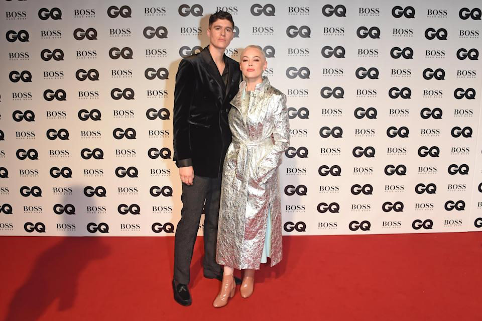 Rain Dove and Rose McGowan at the the GQ Men of the Year Awards 2018 in England on Sept. 5. (Photo: Getty Images)