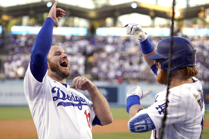 Los Angeles Dodgers' Justin Turner, right, celebrates his solo home run with Max Muncy during the first inning of a baseball game against the San Francisco Giants Monday, July 19, 2021, in Los Angeles. (AP Photo/Mark J. Terrill)