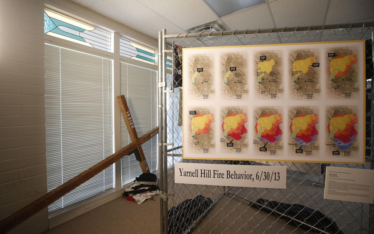 Displays near completion to mark the upcoming one year anniversary of the deaths of 19 Granite Mountain Hotshots for the Tribute Fence Preservation Project on Tuesday, June 24, 2014, in Prescott, Ariz. (AP Photo/Ross D. Franklin)