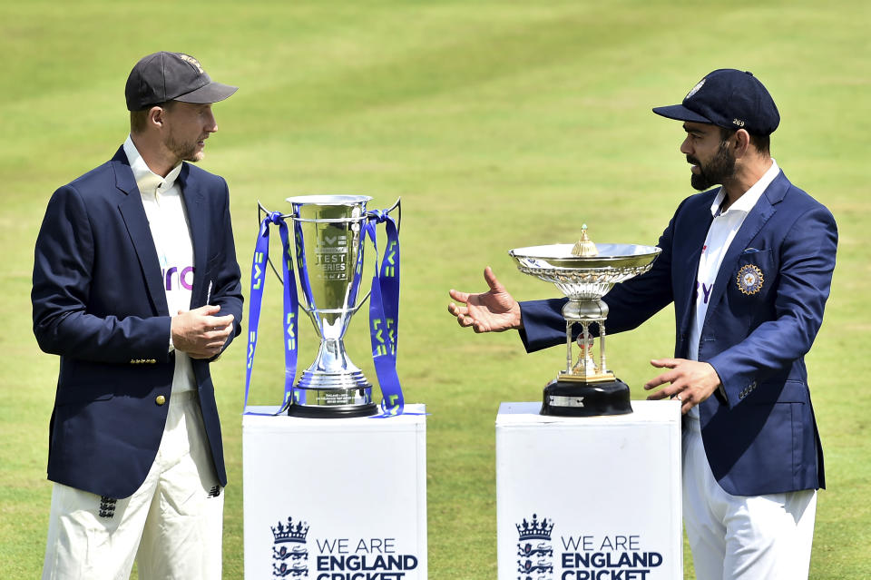 England captain Joe Root, left, and India captain Virat Kohli meet with the trophies prior to the first Test Match between England and India at Trent Bridge cricket ground in Nottingham, England, Monday, Aug. 2, 2021. (AP Photo/Rui Vieira)