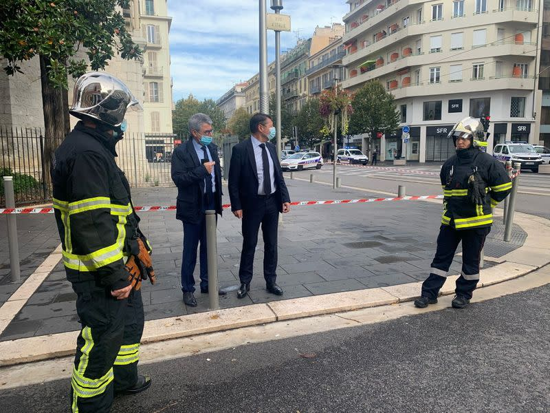 Nice Mayor Christian Estrosi talks to Municipal Police at the site of a knife attack in church in Nice