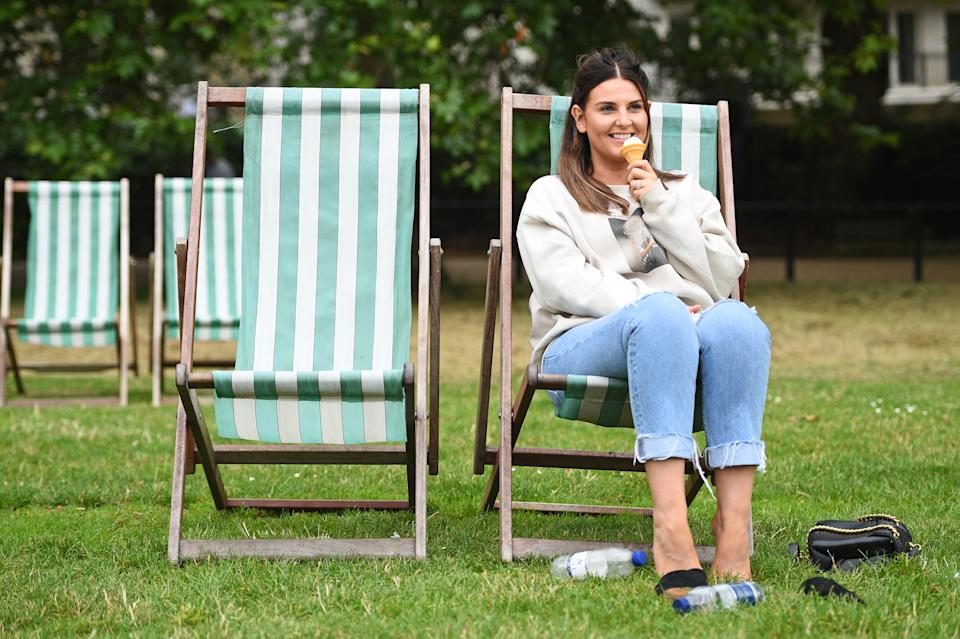 A woman eats an ice-cream in Green Park, London (Picture: PA/Getty)