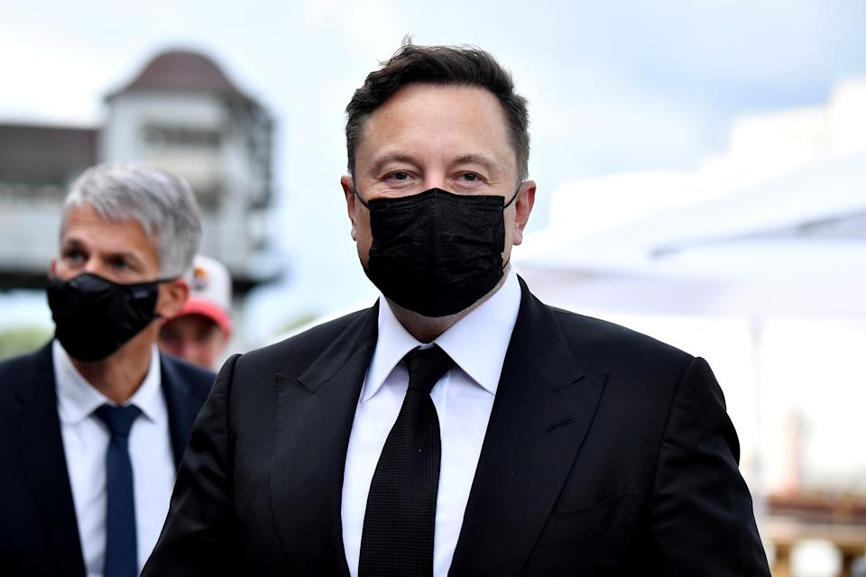 Elon Musk wears a protective mask as he arrives to attend a meeting with the leadership of the conservative CDU/CSU parliamentary group, in Berlin, Germany September 2, 2020. Tobias Schwarz/Pool via REUTERS