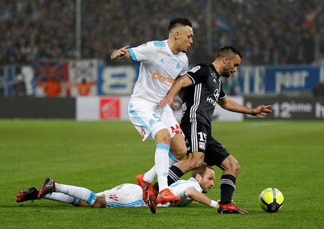 Soccer Football - Ligue 1 - Olympique de Marseille vs Olympique Lyonnais - Orange Velodrome, Marseille, France - March 18, 2018 Marseille's Lucas Ocampos in action with Lyon's Jeremy Morel REUTERS/Philippe Laurenson