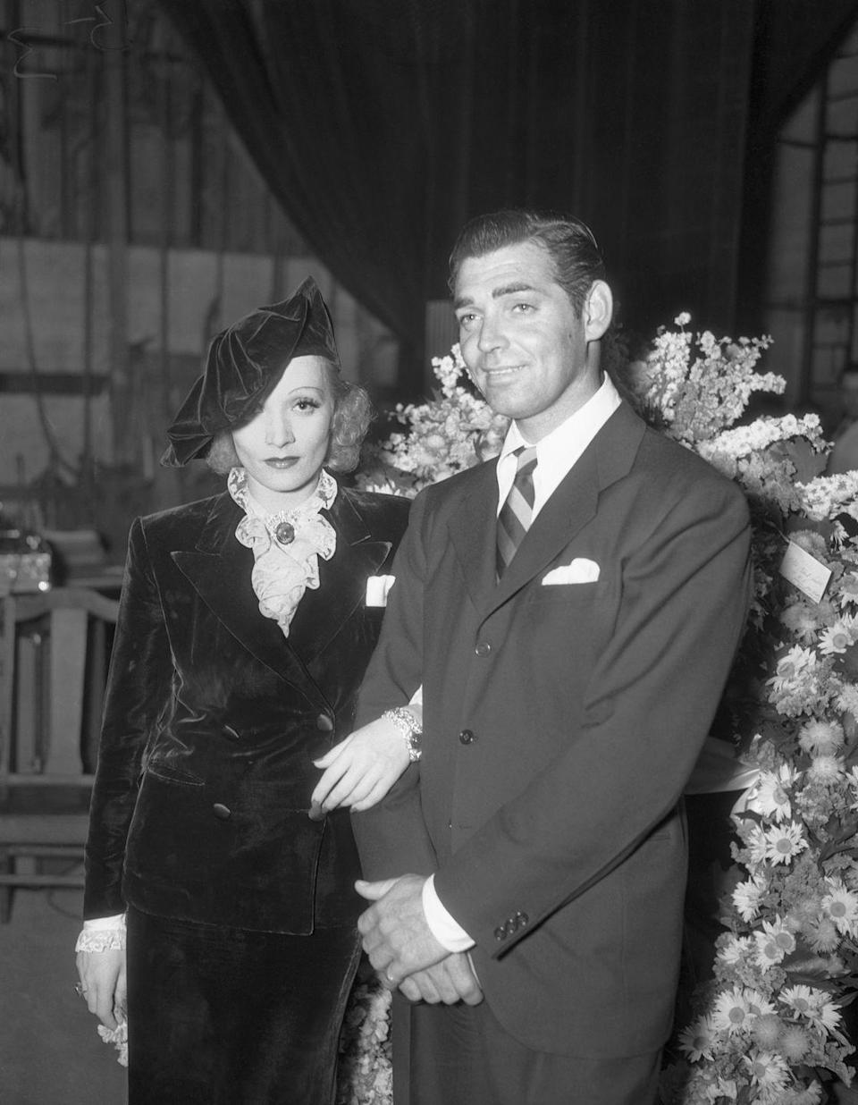 <p>Marlene Dietrich and Clark Gable pose together at the 1936 premiere of <em>T</em><em>heater of the Air</em> in Hollywood.</p>