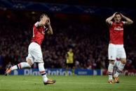 Arsenal's Santi Cazorla (L) and Olivier Giroud react after a missed opportunity during their Champions League soccer match against Borussia Dortmund at the Emirates stadium in London October 22, 2013. REUTERS/Dylan Martinez