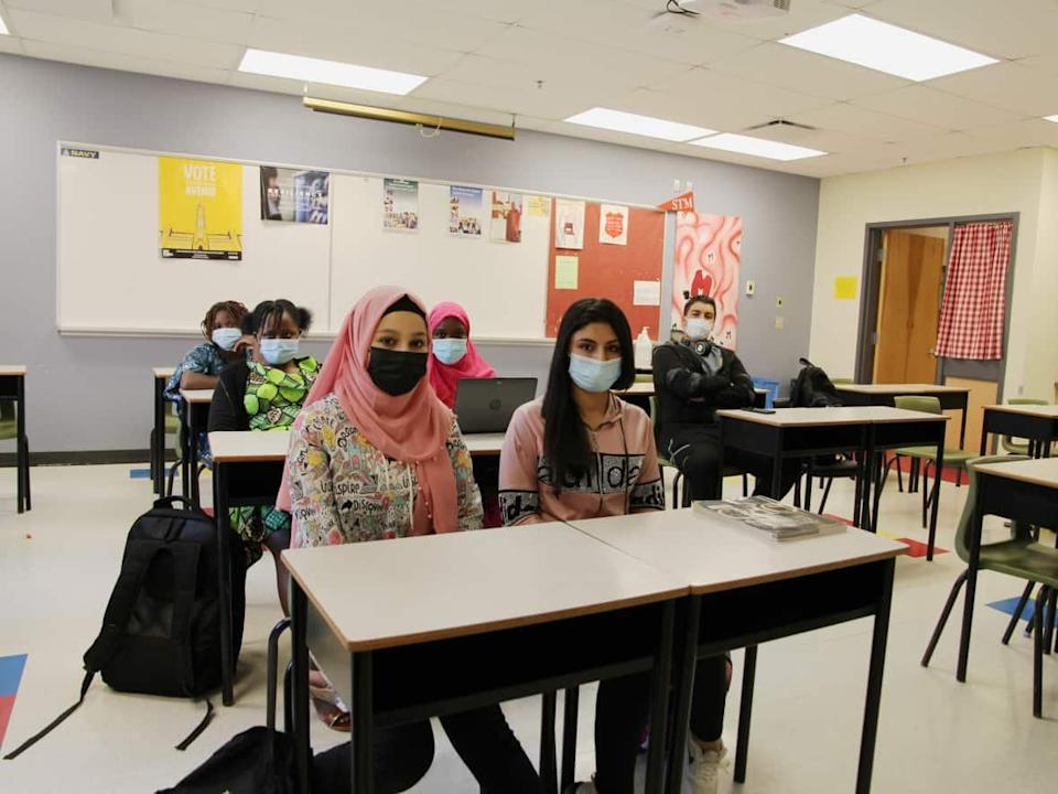 Newcomer students at St. Malachy's High School in Saint John learn the language and culture for up to a year before joining typical classes. (Hadeel Ibrahim/CBC - image credit)