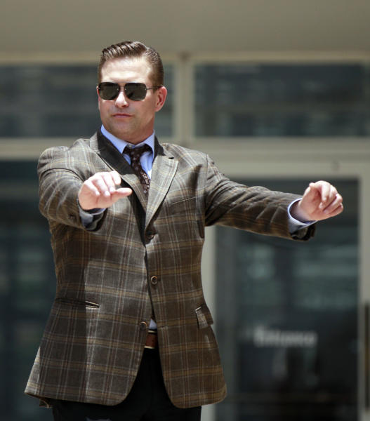 Stephen Baldwin adjusts his suit as he arrives at Federal Court on Thursday, June 14, 2012 in New Orleans. A jury is set to hear closing arguments in the trial for Baldwin's lawsuit against Kevin Costner over their multimillion dollar business dispute in the aftermath of the 2010 oil spill in the Gulf of Mexico. The lawsuit accuses Costner and Smith of duping Baldwin and friend Spyridon Contogouris over their investments in an oil cleanup device that BP used after the spill. (AP Photo/Gerald Herbert)