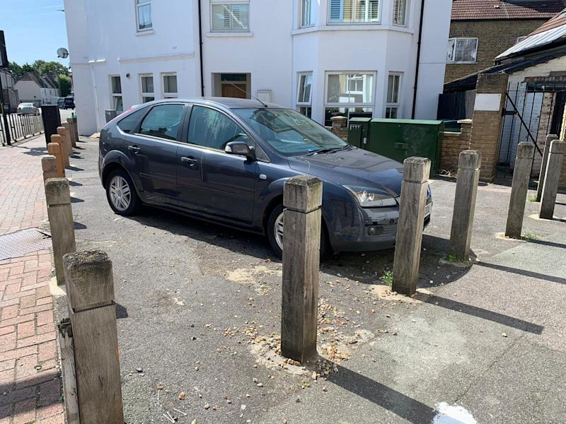 Blocked in - the car after being sandwiched in by three bollards (SWNS)