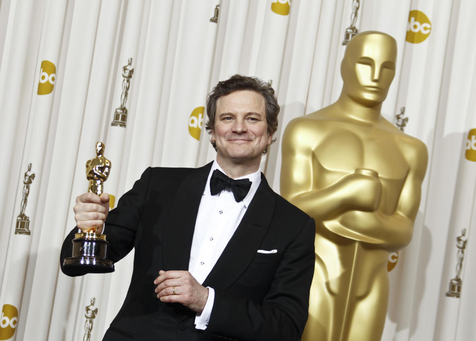 """Colin Firth poses backstage with the Oscar for best performance by an actor in a leading role for """"The King's Speech"""" at the 83rd Academy Awards on Sunday, Feb. 27, 2011, in the Hollywood section of Los Angeles. (AP Photo/Matt Sayles)"""