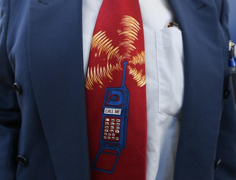 A bidder wearing depicting a ringing mobile phone at the start of Germany's auction for the construction of its ultra-fast 5G mobile network on Tuesday