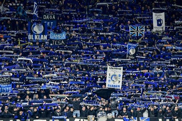Atalanta fans cheer during the UEFA Champions League football match between against Valencia in Milan's San Siro Stadium on February 19. (AFP Photo/Miguel MEDINA)