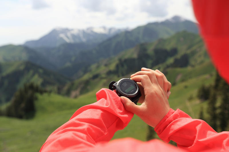 A hiker consults her smartwatch for directions.