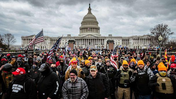 PHOTO: Pro-Trump protesters including Joseph Biggs (plaid shirt) gather in front of the Capitol Building, Jan. 6, 2021, in Washington, D.C. (Jon Cherry/Getty Images)