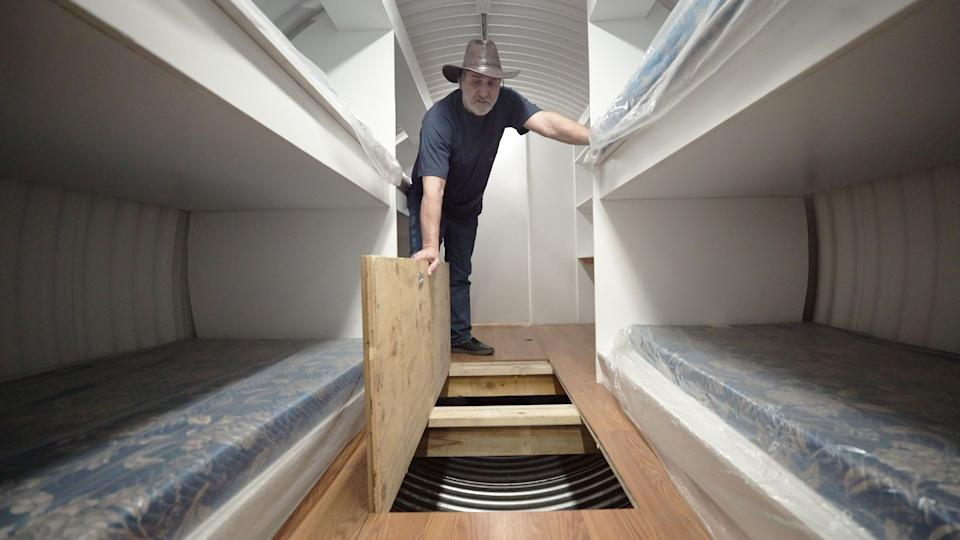 Hubbard showing off the storage space inside of the bunkers. (Photo: Yahoo Finance)