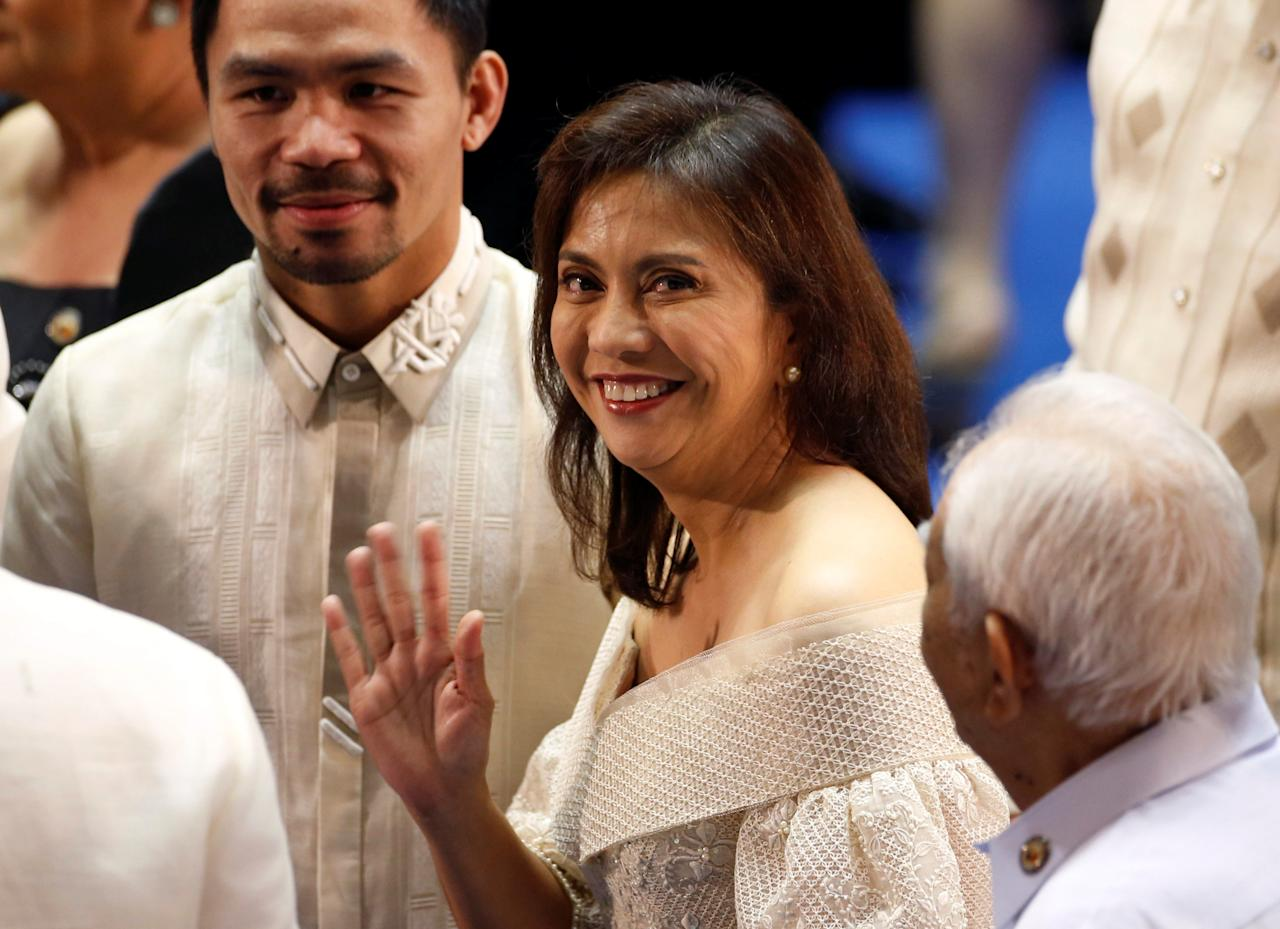Vice-President Leni Robredo (C) waves next to Filipino boxer and Senator Manny Pacquiao as as they arrive before Philippine President Rodrigo Duterte speaks during his first State of the Nation Address at the Philippine Congress in Quezon city, Metro Manila, Philippines July 25, 2016. REUTERS/Erik De Castro