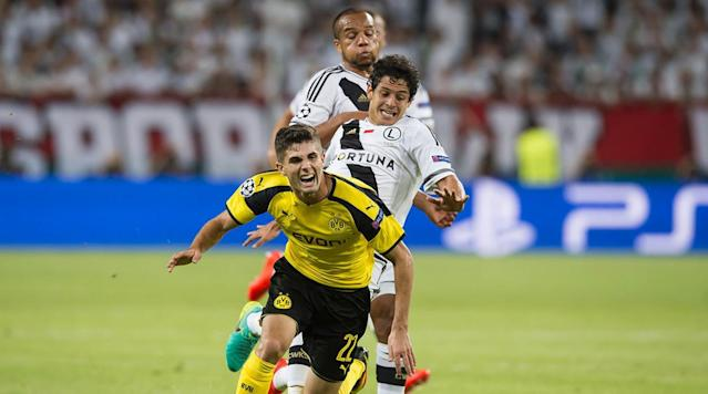 <p>Christian Pulisic of Borussia Dortmund gets challenged by Guilherme of Legia Warszawa during the UEFA Champions League: First Qualifying Round 1st Leg match at Wojska Polskiego Stadium on Sept. 14, 2016 in Warsaw, Poland.</p>