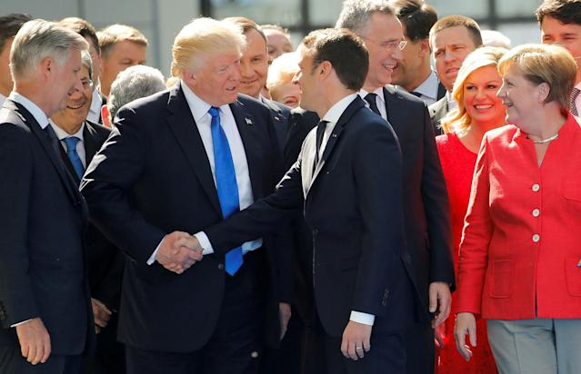 <p>President Donald Trump jokes with French President Emmanuel Macron about their handshakes in front of NATO leaders, including German Chancellor Angela Merkel, NATO Secretary General Jens Stoltenberg (2nd R) and Belgium King Philippe (L), at the start of the NATO summit at their new headquarters in Brussels, Belgium, May 25, 2017. (Photo: Jonathan Ernst/Reuters) </p>