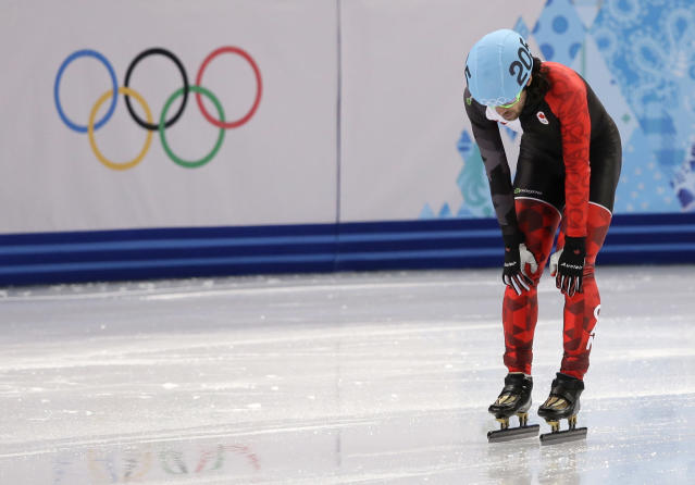 Charles Hamelin of Canada reacts after crashing out in a men's 500m short track speedskating heat at the Iceberg Skating Palace during the 2014 Winter Olympics, Tuesday, Feb. 18, 2014, in Sochi, Russia. (AP Photo/Darron Cummings)