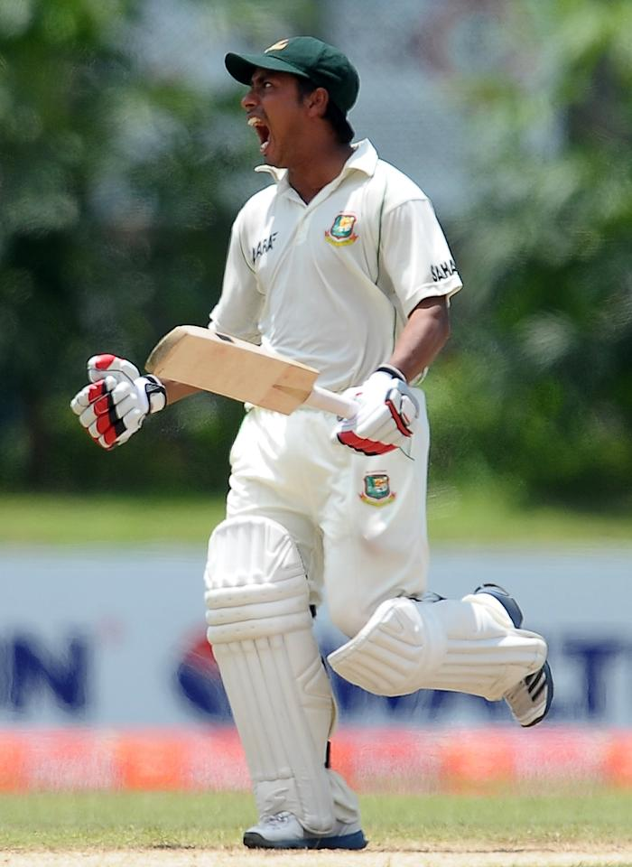 Bangladeshi cricketer Mohammad Ashraful celebrates scoring a century (100 runs) during the third day of the opening Test match between Sri Lanka and Bangladesh at the Galle International Cricket Stadium in Galle on March 10, 2013.   AFP PHOTO/ LAKRUWAN WANNIARACHCHI        (Photo credit should read LAKRUWAN WANNIARACHCHI/AFP/Getty Images)