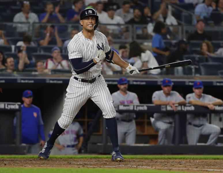 New York Yankees' Giancarlo Stanton reacts after striking out during the fifth inning of a baseball game against the New York Mets Monday, Aug. 13, 2018, in New York. (AP Photo/Frank Franklin II)