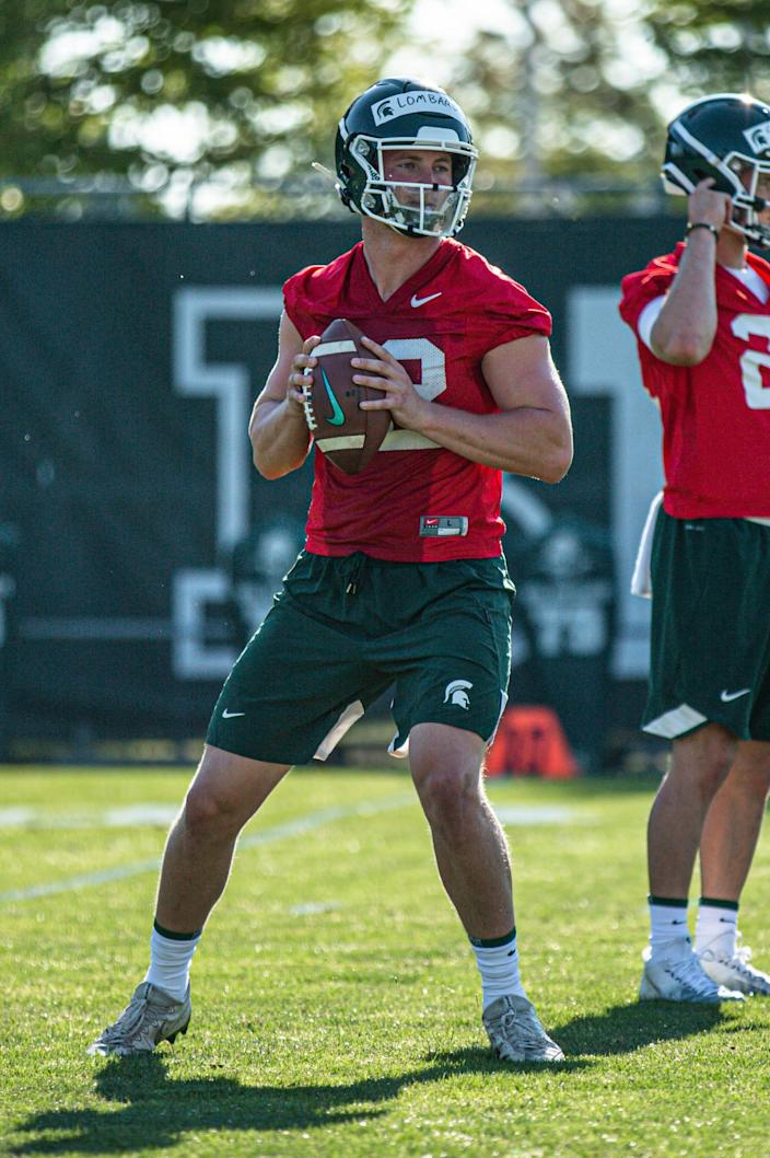 Michigan State quarterback Rocky Lombardi works during practice in August.