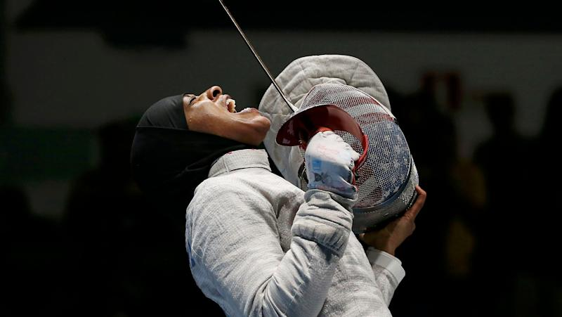 Ibtihaj Muhammad celebrating after she won the women's sabre team semifinals in the 2016 Olympics in Rio de Janeiro.