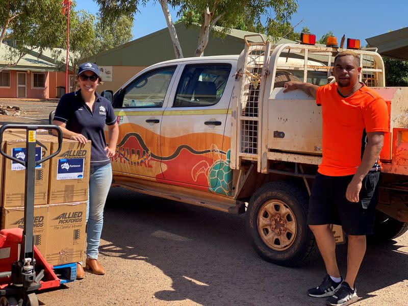 Jaylan Smith of Fortescue Metals Group and Nathan Newland of the Njamal Community get ready to deliver care packages in the Port Hedland region
