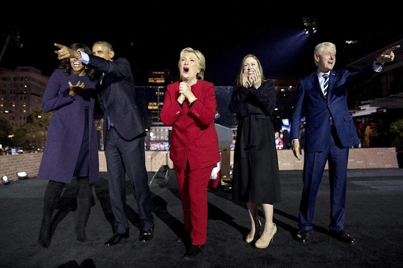 FILE - In this Monday, Nov. 7, 2016, file photo, Democratic presidential candidate Hillary Clinton, center, is joined onstage by first lady Michelle Obama, left, President Barack Obama, second from left, Chelsea Clinton, second from right, and former President Bill Clinton, right, after speaking at a rally at Independence Mall in Philadelphia. The former secretary of state, senator and first lady is working on a collection of personal essays that will touch upon the 2016 presidential campaign, Simon & Schuster told The Associated Press on Wednesday, Feb. 1, 2017. The book, currently untitled, is scheduled for this fall and will be inspired by favorite quotations she has drawn upon. (AP Photo/Andrew Harnik, File)