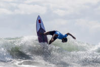 Morocco's Ramzi Boukhiam rides a wave during the first round of the men's surfing competition at the 2020 Summer Olympics, Sunday, July 25, 2021, at Tsurigasaki beach in Ichinomiya, Japan. (Olivier Morin/Pool Photo via AP)