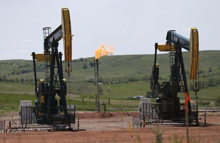 Oil pumps and natural gas burn off in Watford City, N.D.