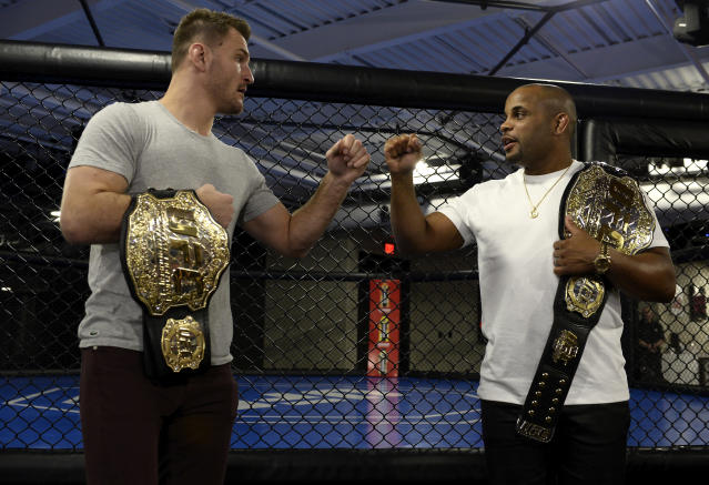 Stipe Miocic and Daniel Cormier bump fists inside the UFC Performance institute on Feb. 2, 2017 in Las Vegas, Nevada. (Getty Images)
