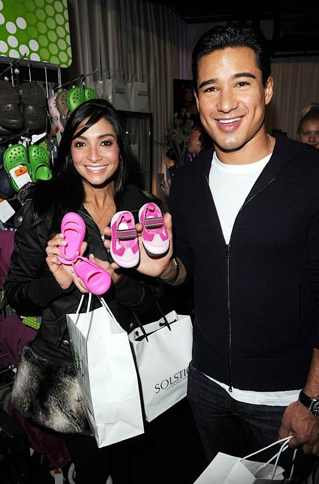 """New parents Courtney Mazza and Mario Lopez left the Samsung Galaxy Tab Lift laden with bags of goodies, including some cute shoes for their baby girl Gia. Jason Merritt/<a href=""""http://www.wireimage.com"""" target=""""new"""">WireImage.com</a> - January 22, 2011"""