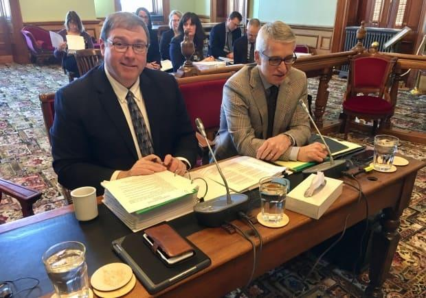 Eric Beaulieu, deputy minister of the Department of Social Development, left, was questioned on his department's handling of a number of files, including the improvement of conditions for youth in group homes.  (Jacques Poitras/CBC - image credit)