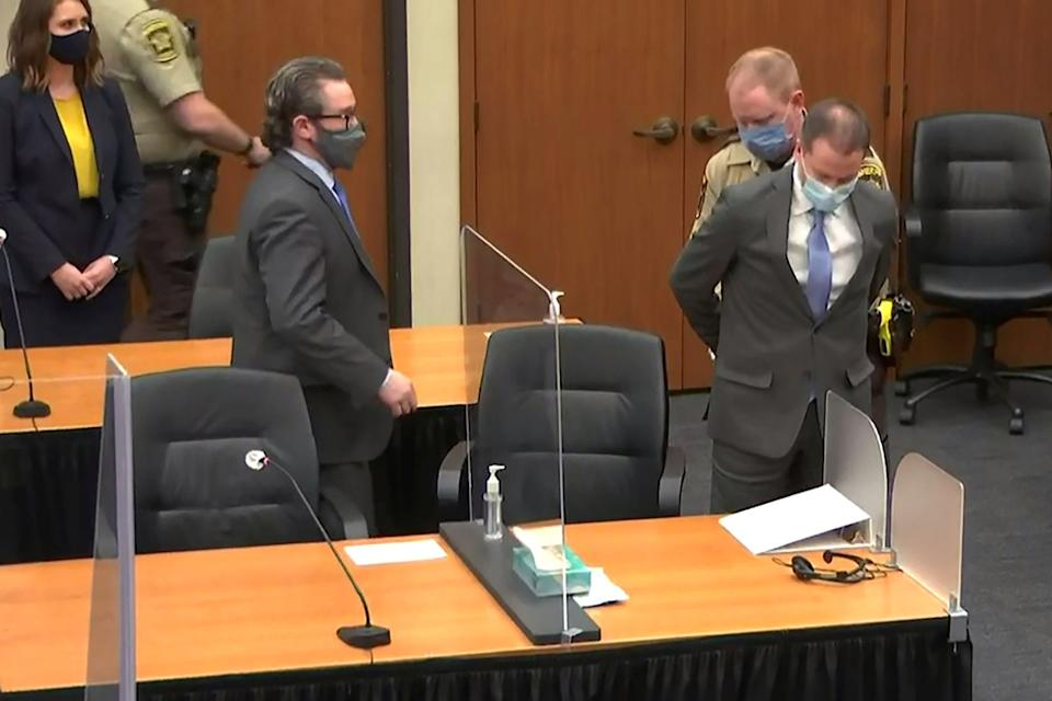 Former Minneapolis police officer Derek Chauvin is handcuffed to be led away after a jury found him guilty of all charges in his trial for second-degree murder, third-degree murder and second-degree manslaughter in the death of George Floyd in Minneapolis, Minnesota, U.S. April 20, 2021 in a still image from video.  Court TV/Pool via Reuters)