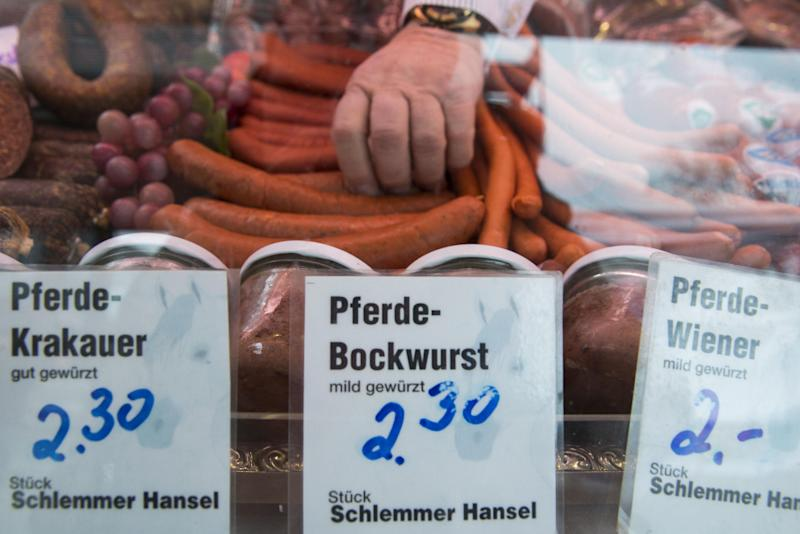 Butcher Norbert Hansel, specialized on horse meat, takes horse meat sausages in his sales car at a market in Berlin, Germany, Monday, Feb. 18, 2013. German federal and state agriculture ministers meet in Berlin to discuss the horse meat scandal. (AP Photo/Gero Breloer)