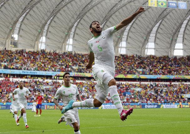 Algeria's Rafik Halliche (5) celebrates after scoring his side's second goal during the group H World Cup soccer match between South Korea and Algeria at the Estadio Beira-Rio in Porto Alegre, Brazil, Sunday, June 22, 2014. (AP Photo/Lee Jin-man)