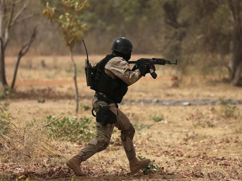 A soldier from Burkina Faso participates in a simulated raid during the US sponsored Flintlock exercises: REUTERS