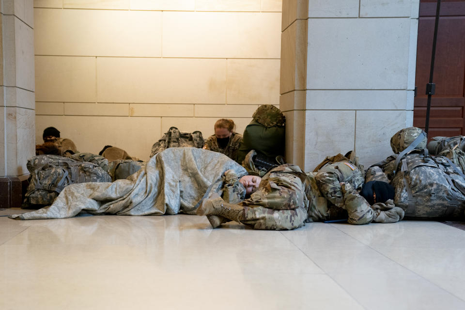 WASHINGTON, DC - JANUARY 13: Members of the National Guard sleep on the floor of the U.S. Capitol on January 13, 2021 in Washington, DC. Security has been increased throughout Washington following the breach of the U.S. Capitol last Wednesday, and leading up to the Presidential inauguration. (Photo by Stefani Reynolds/Getty Images)