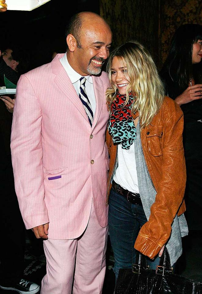 """Ashley Olsen's sloppy attire and shoe designer Christian Louboutin's pink suit definitely make them stand out in the crowd. Donato Sardella/<a href=""""http://www.wireimage.com"""" target=""""new"""">WireImage.com</a> - October 17, 2007"""
