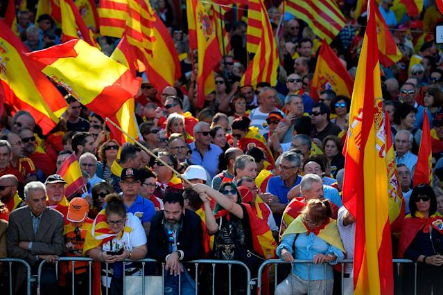 <p>People wave Spanish flags during a pro-unity demonstration in Barcelona on Oct. 29, 2017. (Photo: Lluis Gene/AFP/Getty Images) </p>