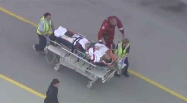 Mr Travaglini was transported to hospital after being bitten by a shark. Source: 7 News